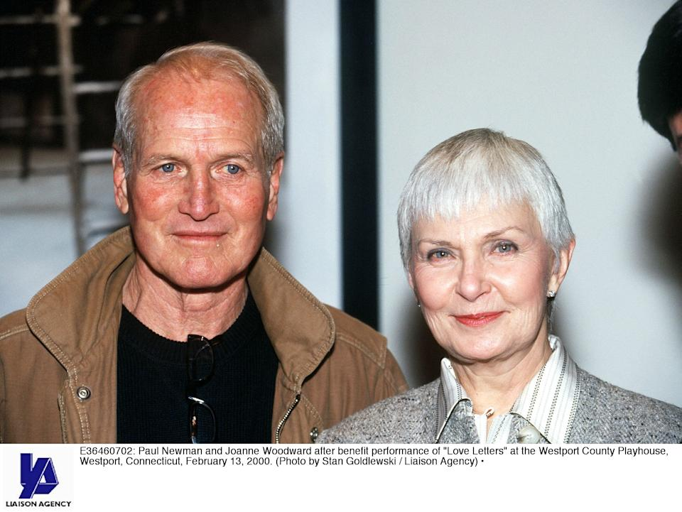 E36460702: Paul Newman And Joanne Woodward After Benefit Performance Of