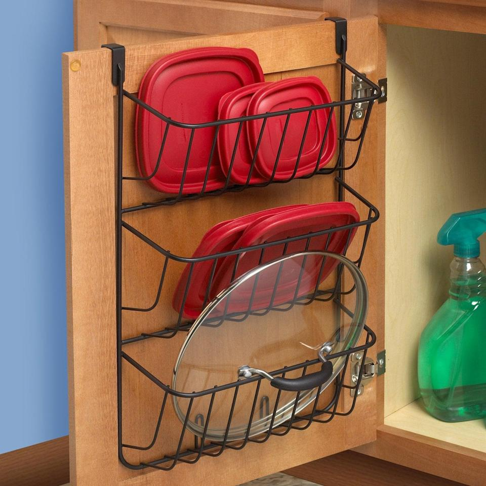 <p>If your cabinets are always overflowing with container and pot lids, get this <span>Spectrum Diversified Over-the-Cabinet 3-Tier Lid Holder</span> ($24) to keep them together.</p>