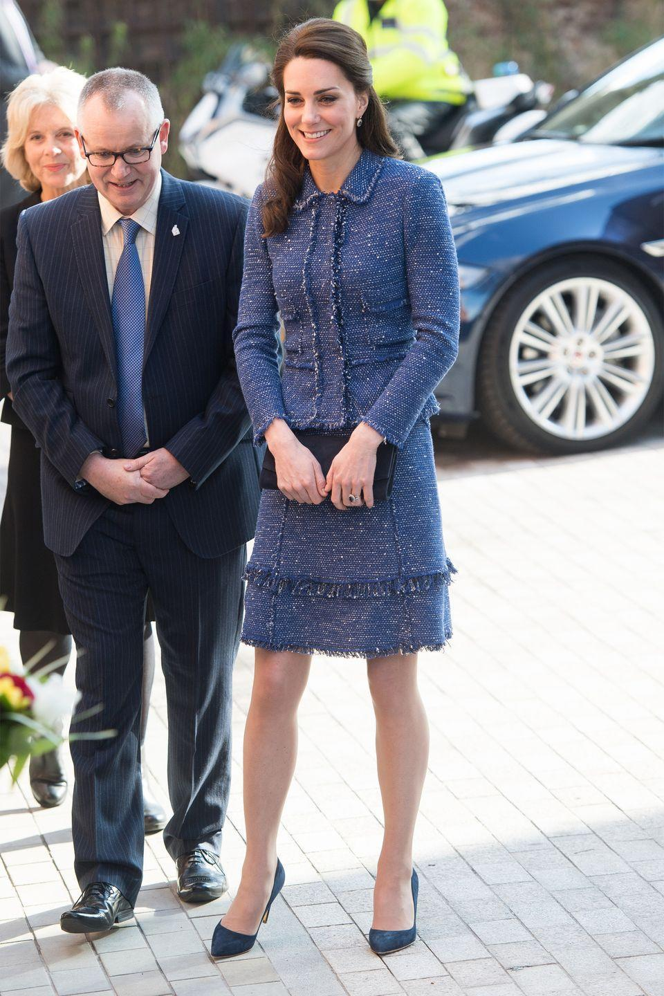 <p>Middleton wears a blue tweed skirt suit with fringe details by Rebecca Taylor with a dark navy clutch and suede pumps while visiting Ronald McDonald House Evelina London.</p>