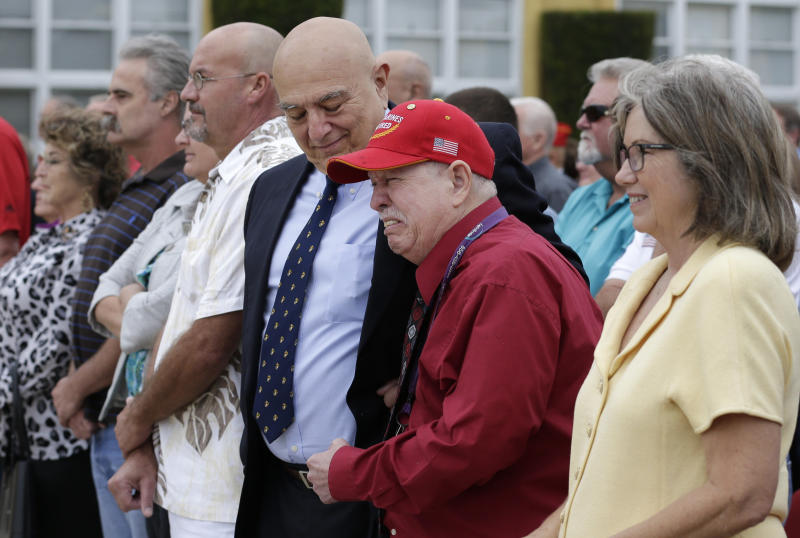 Retired Marine Joe Cordileone, center, looks down as he consoles retired Marine veteran Kenneth Pollack, second from right, during a ceremony to honor Cordileone at Marine Corps Recruit Depot Friday, Sept. 20, 2013, in San Diego. Cordileone, a Vietnam War veteran, was awarded the Silver Star Medal, 46 years after he fought North Vietnamese army troops on a jungle hillside, and saw 75 percent of his unit killed or wounded. Pollack took part in the battle that same day. (AP Photo/Gregory Bull)