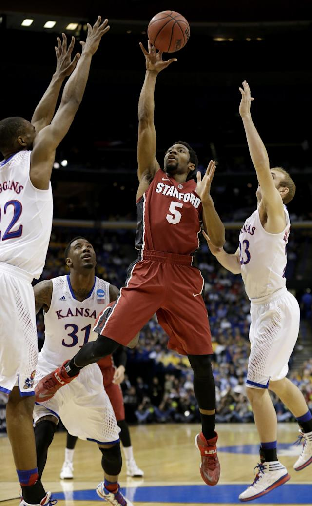 Stanford's Chasson Randle (5) gets between Kansas's Andrew Wiggins, left, Conner Frankamp (23) and k23=, right, to shoot during the first half of a third-round game at the NCAA college basketball tournament Sunday, March 23, 2014, in St. Louis. (AP Photo/Charlie Riedel)