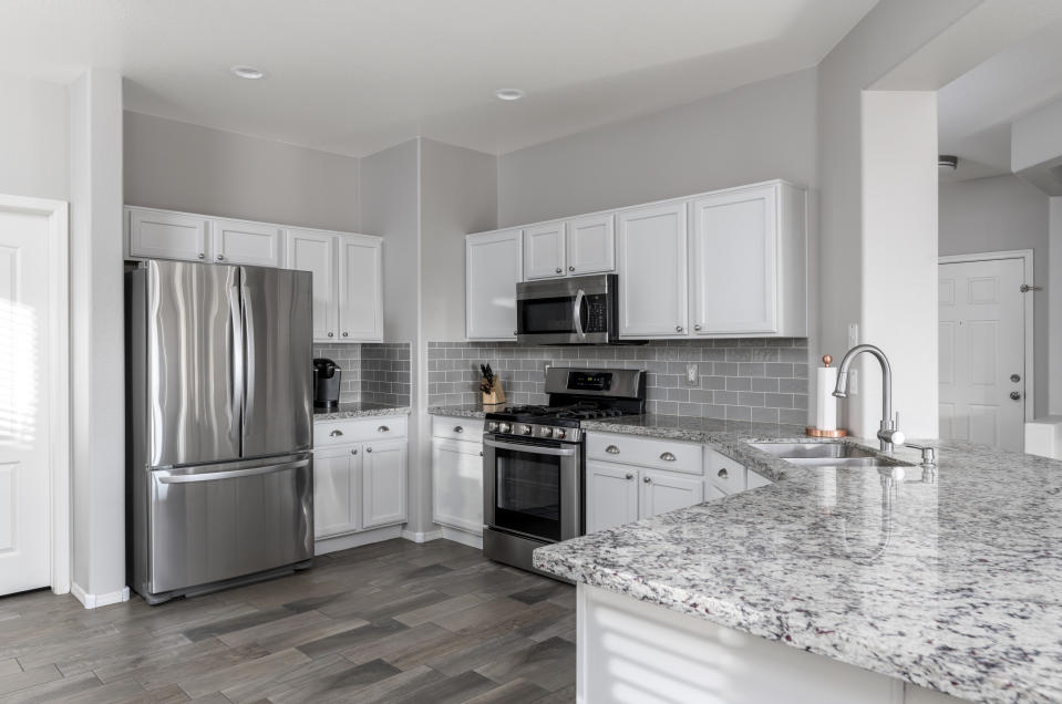 Color photo of a beautiful modern kitchen.