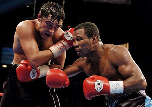 Shane Mosley works against Oscar De La Hoya during their 2003 bout. (AP)
