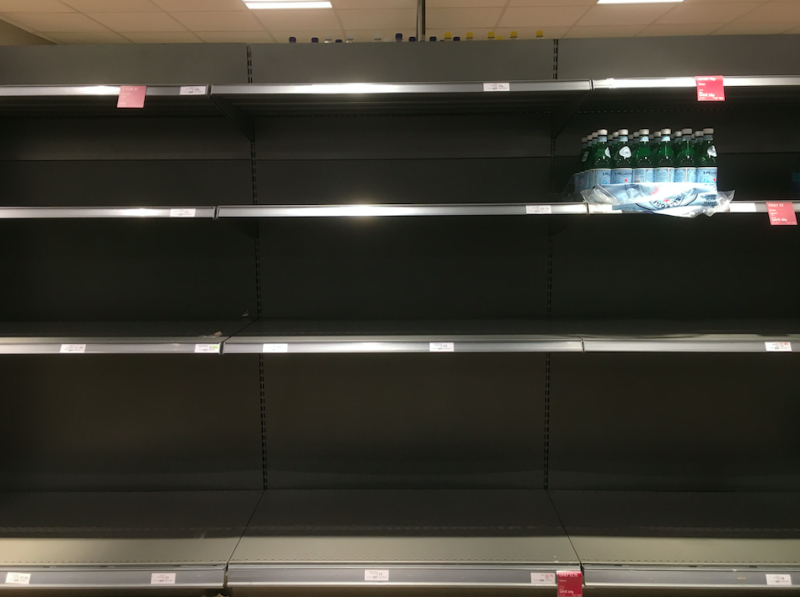 Shelves were stripped of bottles as residents were left without water (PA)
