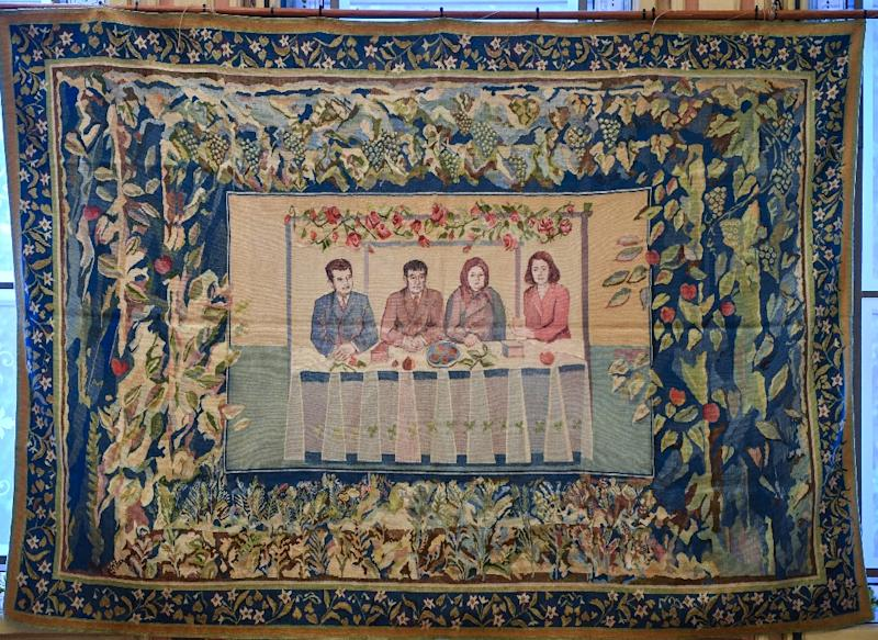 A tapestry showing late Romanian dictator Nicolae Ceausescu (L), his parents(C) and his wife Elena (R) is displayed at an auction house in Bucharest (AFP Photo/Daniel MIHAILESCU)