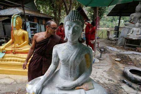 Jeremy, a Buddhist monk from Australia, inspects a Buddha statue at a workshop at the rehabilitation and detox area at Wat Thamkrabok monastery in Saraburi province, Thailand, February 3, 2017. REUTERS/Jorge Silva