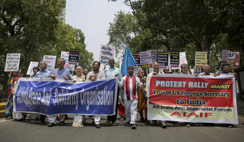 Activists of various left organizations protest against the upcoming visit of U.S. Secretary of State Mike Pompeo to India, in New Delhi, India, Tuesday, June 25, 2019. Pompeo is scheduled to travel to India after having visited Saudi Arabia and the United Arab Emirates, on a trip aimed at building a global coalition to counter Iran. (AP Photo/Altaf Qadri)