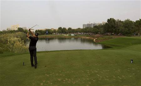 Henrik Stenson of Sweden drives from the tee on the eighth hole during the final round of the DP World Tour Championship in Dubai November 17, 2013. REUTERS/Caren Firouz