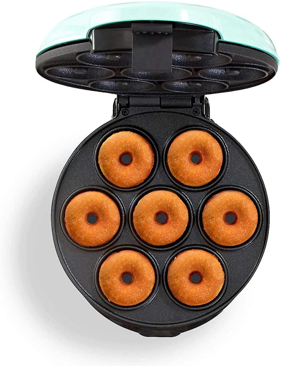 <p>Make the yummiest homemade donuts with the <span>Dash Mini Donut Maker Machine</span> ($20). It's got a non-stick surface and it's super easy to use. You can make up to seven donuts at once!</p>