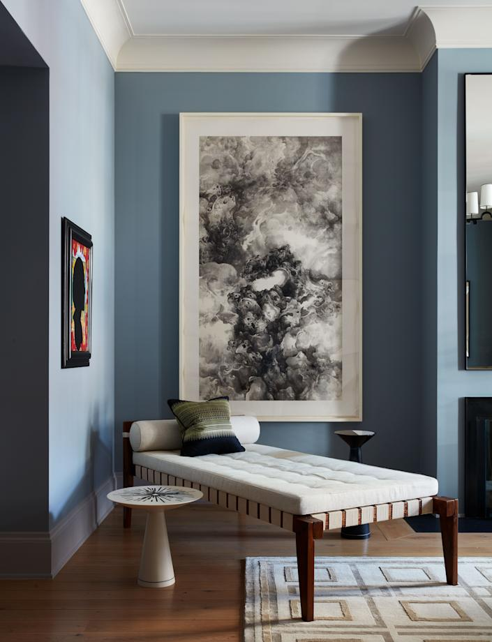 """My extensive travels through Asia have had a lasting influence on me,"" says Nunnerley. In a corner of the living room a work by Chinese artist Tai Xiangzhou hangs above a Pierre Jeanneret chaise longue. A small painting to the left is a portrait of Nunnerley by New York artists (and longtime friends) McDermott & McGough. A side table from Nunnerley's Celestial Collection for Maison Gerard. Decorative cushion of hand-woven fabric found on a trip to Lake Inle in Myanmar. Madison hand-knotted wool and silk rug from Nunnerley's collection for The Rug Company."