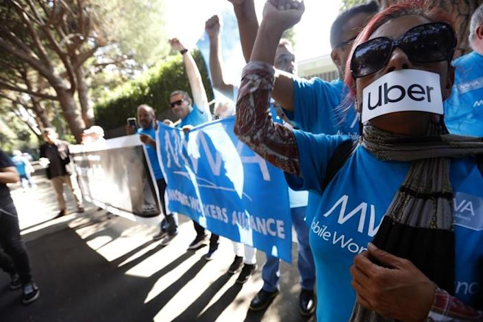 Genaro MolinaLos Angeles Times UBER AND LYFT driver Teresa Mercado, right, joins members of the Mobile Workers Alliance, which consists of Uber and Lyft drivers, protesting at the home of Uber co-founder Garrett Camp in Beverly Hills.