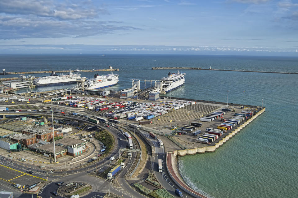 View at Dover port with ferries and lorries in sight.