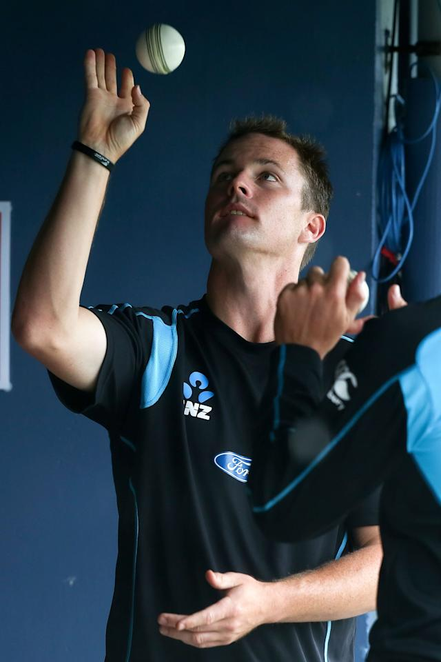 NAPIER, NEW ZEALAND - DECEMBER 29:  Colin Munro of New Zealand keeps himself occupied during a rain delay prior to game two of the One Day International series between New Zealand and the West Indies at McLean Park on December 29, 2013 in Napier, New Zealand.  (Photo by Hagen Hopkins/Getty Images)
