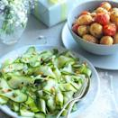 """<p>No barbecue is complete without some scrumptious salads filling the table. Mixed with pine nuts and lemon, this courgette salad is delicious with chicken kebabs.</p><p><strong>Recipe: <a href=""""https://www.goodhousekeeping.com/uk/food/recipes/a536875/ribboned-courgette-salad/"""" rel=""""nofollow noopener"""" target=""""_blank"""" data-ylk=""""slk:Ribboned courgette salad"""" class=""""link rapid-noclick-resp"""">Ribboned courgette salad</a></strong></p>"""