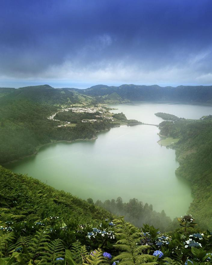 """<p>São Miguel is the most populous island in the Portuguese Azores, with a lively city center and plenty of cultural excursions. But it's also nicknamed the """"green island,"""" thanks to the lush mountains that stretch out in every direction. </p>"""