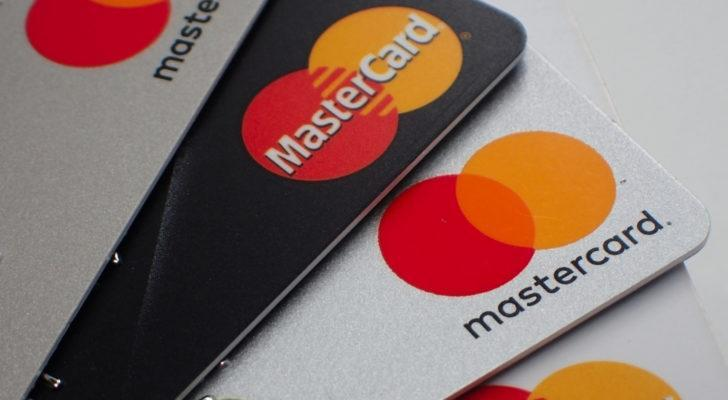 Close up of a pile of mastercard credit load debit bank cards.