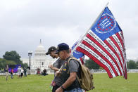 """People arrive to attend a rally near the U.S. Capitol in Washington, Saturday, Sept. 18, 2021. The rally was planned by allies of former President Donald Trump and aimed at supporting the so-called """"political prisoners"""" of the Jan. 6 insurrection at the U.S. Capitol. (AP Photo/Alex Brandon)"""