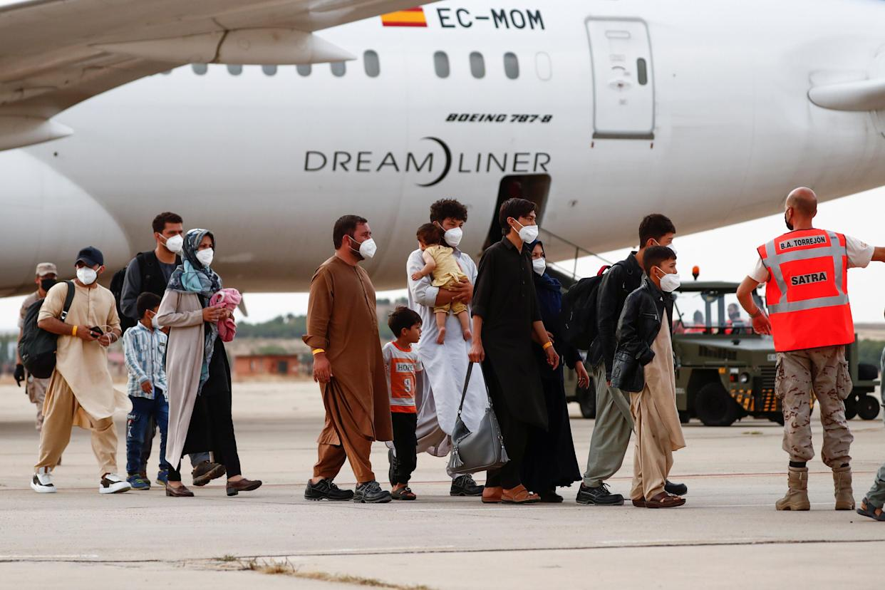 Afghan citizens who have been evacuated from Kabul arrive at Torrejon Air Base in Torrejon de Ardoz, outside Madrid, Spain, August 24, 2021. REUTERS/Javier Barbancho