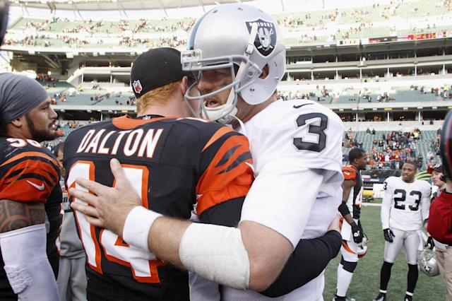 CINCINNATI, OH - NOVEMBER 25: Former Bengal Carson Palmer #3 of the Oakland Raiders shares a moment with Andy Dalton #14 of the Cincinnati Bengals after their game at Paul Brown Stadium on November 25, 2012 in Cincinnati, Ohio. The Bengals defeated the Raiders 34-10. (Photo by John Grieshop/Getty Images)