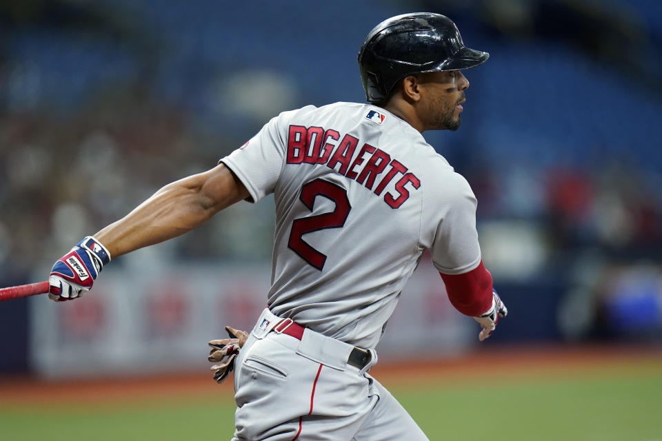 Boston Red Sox's Xander Bogaerts watches his RBI single off Tampa Bay Rays starting pitcher Ryan Yarbrough during the first inning of a baseball game Tuesday, Aug. 31, 2021, in St. Petersburg, Fla. Boston's J.D. Martinez scored on the hit. (AP Photo/Chris O'Meara)