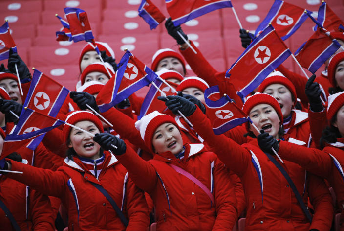 FILE - In this Feb. 14, 2018, file photo, members of the North Korean delegation wave flags at the women's slalom at Yongpyong alpine center at the 2018 Winter Olympics in Pyeongchang, South Korea. At Pyeongchang, North Korea had no real medal contenders, but it was among the most watched nations at the Games, with a huge delegation highlighted by a 229-member strong, all-female cheering squad. (AP Photo/Christophe Ena, File)