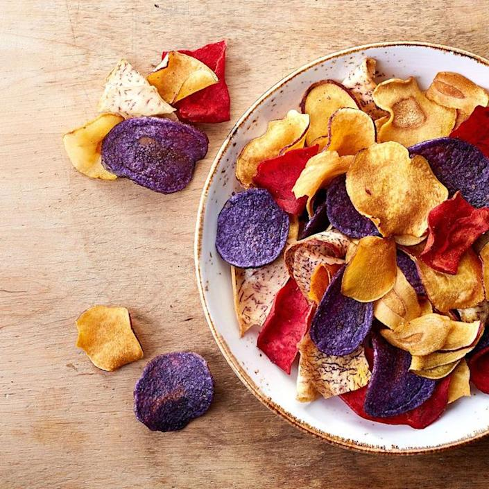 """<p>A fried chip is a fried chip, no matter if it's made from beets or potatoes. """"The harmful ingredient isn't (necessarily) the thing being fried but the saturated and trans fats being used in the frying process,"""" says <a href=""""http://dradrienneyoudim.com/"""" rel=""""nofollow noopener"""" target=""""_blank"""" data-ylk=""""slk:Adrienne Youdim"""" class=""""link rapid-noclick-resp"""">Adrienne Youdim</a>, M.D., physician nutrition specialist at the Center for Nutrition in Beverly Hills. Plus, most veggie chips have potatoes listed as their first ingredient and contain the same amount of calories as regular potato chips, adds Rubin. Try baking your own <a href=""""http://www.womenshealthmag.com/food/how-to-make-kale-chips"""" rel=""""nofollow noopener"""" target=""""_blank"""" data-ylk=""""slk:veggie chips"""" class=""""link rapid-noclick-resp"""">veggie chips</a> from kale, carrots, or zucchini instead to cut back on the fat and sodium and pack in more nutrients.</p>"""