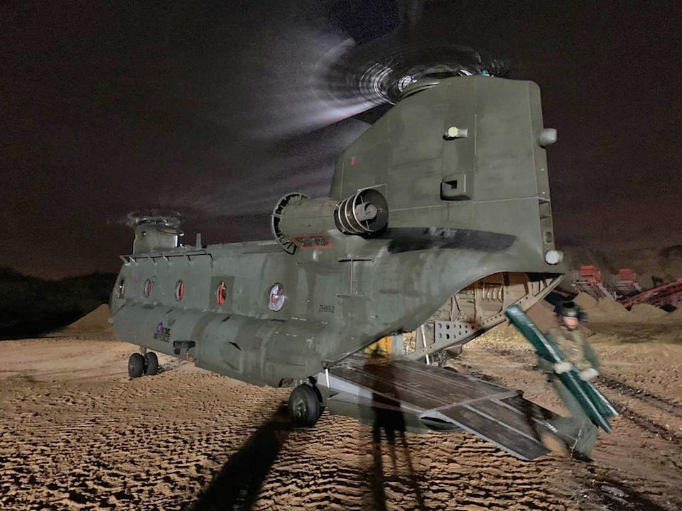 An RAF Chinook in Doncaster helps with the battle against the floods (Picture: PA)