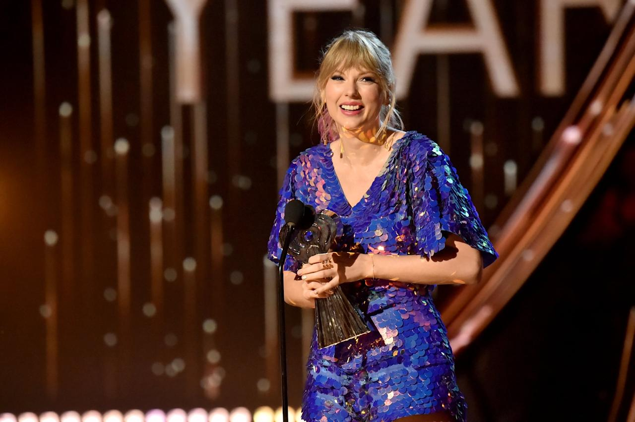 """<p>In 2019, Taylor stepped back into the spotlight in a big way. During her <strong>Reputation</strong> era, she let her music do the talking, but this time around she was pretty much an open book. Not only did she <a href=""""https://www.popsugar.com/celebrity/Taylor-Swift-Ellen-DeGeneres-Show-2019-46156920"""" class=""""ga-track"""" data-ga-category=""""Related"""" data-ga-label=""""http://www.popsugar.com/celebrity/Taylor-Swift-Ellen-DeGeneres-Show-2019-46156920"""" data-ga-action=""""In-Line Links"""">do way more interviews</a> and attend award shows, but <a href=""""https://www.popsugar.com/entertainment/What-Theme-Taylor-Swift-Seventh-Album-45921861"""" class=""""ga-track"""" data-ga-category=""""Related"""" data-ga-label=""""http://www.popsugar.com/entertainment/What-Theme-Taylor-Swift-Seventh-Album-45921861"""" data-ga-action=""""In-Line Links"""">she was also more active on social media</a>. After a trying past few years, Taylor slowly began to let her fans back into her life.</p>"""