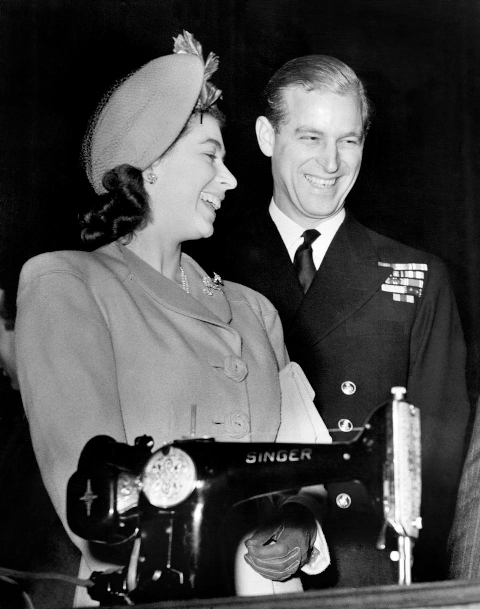<p>The soon to be married Princess Elizabeth and Lieutenant Philip Mountbatten chuckled over an electric sewing machine, a wedding present gifted to them on behalf of a Scottish town. Photo: Getty Images.</p>