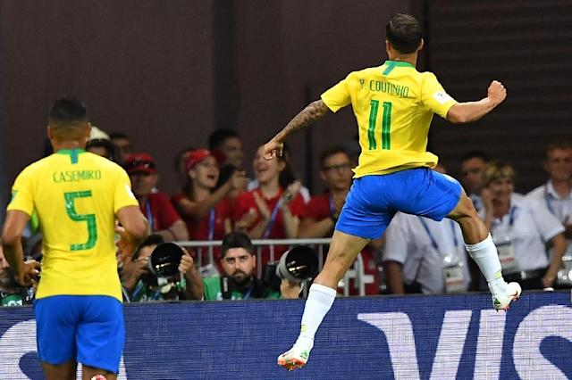 Brazil's Philippe Coutinho (right) celebrates his goal against Switzerland (AFP Photo/JOE KLAMAR)