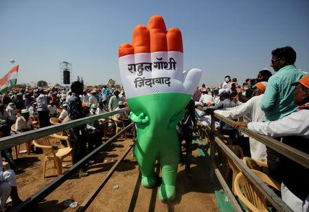 "FILE PHOTO: A supporter wearing an inflatable symbol of India's main opposition Congress party walks during a public meeting in Gandhinagar, Gujarat, India, March 12, 2019. The words read: ""Long live Rahul Gandhi"". REUTERS/Amit Dave/File Photo"