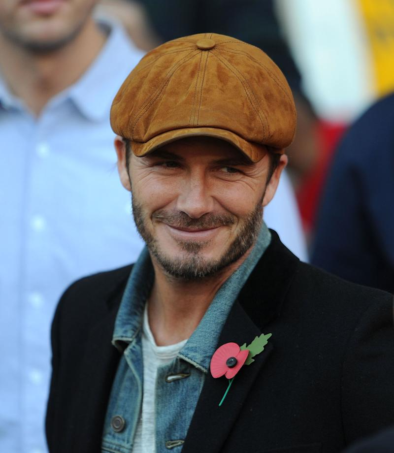 Beckham's hair has earned him a lot of praise over the years, but we think his headwear choices have also been worthy of accolade. He wore this casual suede cap while watching a match between Arsenal and Burnley in the Barclays Premier League 2014.