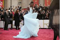<p>2014 was a huge year for Lupita Nyong'o, who took home the Oscar for Best Supporting Actress thanks to her role in 12 Years A Slave. For the occasion, the actress wore the most elegant blue Prada pleated gown, which she playfully twirled in on the red carpet, and immediately had her topping best-dressed lists the world over.</p>