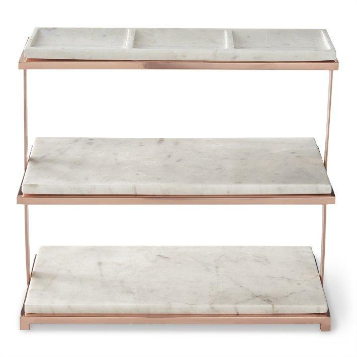 """<p>Utilize this sleek stand for a charcuterie spread while sipping on cocktails, or display mini pastries and desserts on it at the end of the night. It will add another element to your tablescape and make you feel like the hostess with the mostest.</p> <p><strong>To buy: </strong>$78; <a href=""""http://williams-sonoma.7eer.net/c/249354/265127/4291?subId1=RS%2C7EntertainingEssentialsforaSuccessfulParty%252CNoMattertheOccasion%2Crsylvester805%2CENT%2CIMA%2C639893%2C201910%2CI&u=https%3A%2F%2Fwww.williams-sonoma.com%2Fproducts%2Fmarble-and-copper-three-tiered-stand"""" title=""""(opens new window)"""" target=""""_blank"""">williams-sonoma.com</a></p>"""