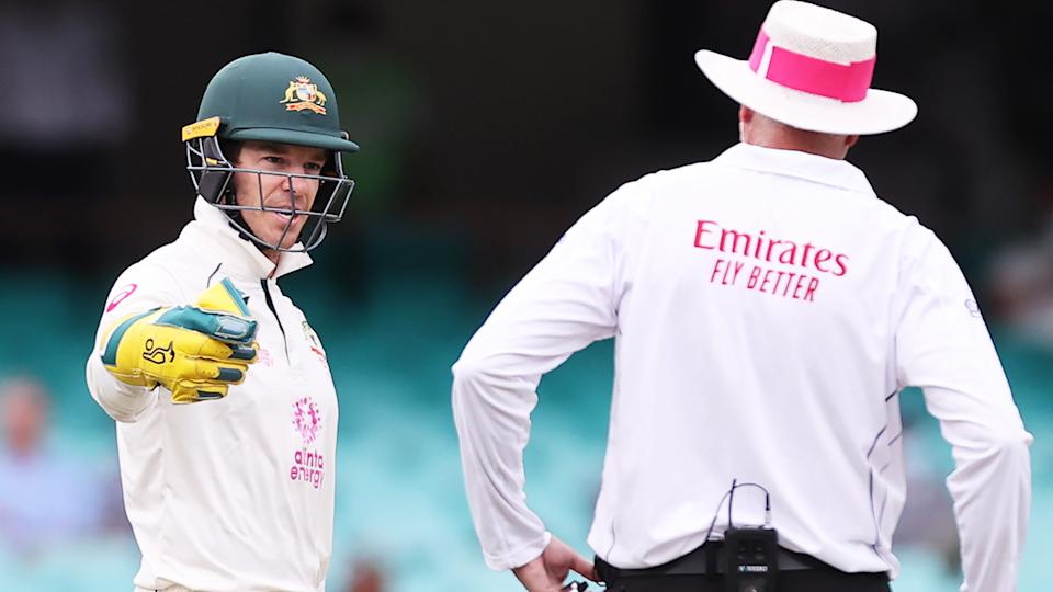 Australia's captain Tim Paine speaks with an umpire during  the third cricket Test match between Australia and India at the Sydney Cricket Ground. (Photo by DAVID GRAY/AFP via Getty Images)