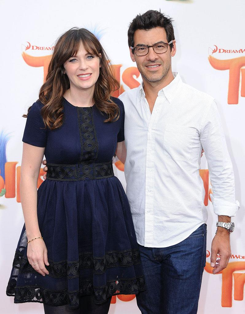 Zooey Deschanel and Jacob Pechenik attend the premiere of 'Trolls' in October.