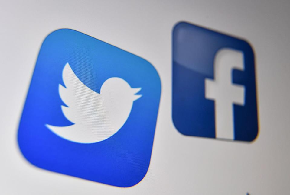 Logo of the the American online social media and social networking service, Facebook and Twitter on a computer screen in Lille (AFP via Getty Images)
