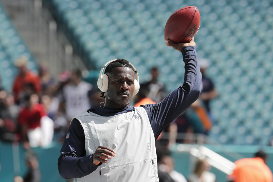New England Patriots wide receiver Antonio Brown warms up before an NFL football game against the Miami Dolphins, Sunday, Sept. 15, 2019, in Miami Gardens, Fla. (AP Photo/Lynne Sladky)