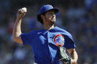 Chicago Cubs starting pitcher Yu Darvish works against a Milwaukee Brewers batter during the first inning of a spring training baseball game Saturday, Feb. 29, 2020, in Mesa, Ariz. (AP Photo/Gregory Bull)