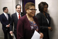 "FILE - In this Dec. 9, 2019, file photo Rep. Karen Bass, D-Calif., center, walks out of a hearing room with Rep. Jamie Raskin, D-Md., second from left, and Rep. Val Demings, D-Fla., right, during a break as the House Judiciary Committee hears investigative findings in the impeachment inquiry of President Donald Trump on Capitol Hill in Washington. ""Everything resides on Jan. 5 and whether or not we win those Senate seats,"" Bass said. ""If we do not win those Senate seats, then it is not going to be the full-force, full agenda that all of us would like to see take place."" Bass said President-elect Joe Biden could run into similar challenges President Barack Obama faced from a Republican-majority Senate that stalled much of his agenda. (AP Photo/Patrick Semansky, File)"