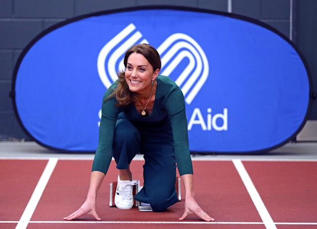 The Duchess of Cambridge is shown how to use the starting blocks at the London Stadium. (Press Association)