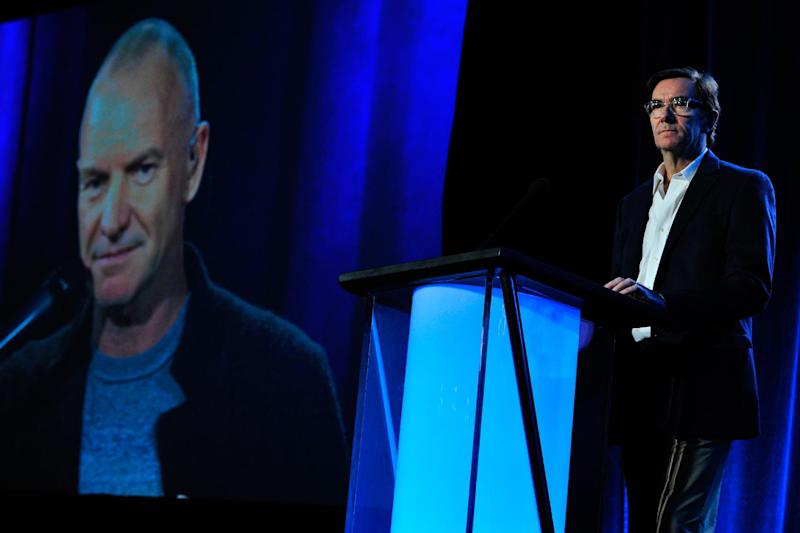 """This photo provided by PBS shows, Sting, left, (via satellite) and executive-in-charge Stephen Segaller discussing the special """"Sting: The Last Ship,"""" during """"PBS' Great Performances"""" session at the Television Critics Association Winter Press Tour in Pasadena, Calif., on Monday, January 20, 2014. The special highlights songs from the artist's Broadway-bound show about the demise of ship-building. Sting's PBS special, """"Sting: The Last Ship,'' airs Feb. 21, 2014, on """"Great Performances.'' (AP Photo/PBS, Rahoul Ghose)"""