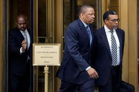 FILE PHOTO: Lamont Evans (C), former associate head basketball coach for Oklahoma State University, exits the Manhattan Federal Courthouse, following an appearance for bribery and fraud charges in connection with college basketball recruiting, in New York, U.S., October 12, 2017. REUTERS/Brendan McDermid