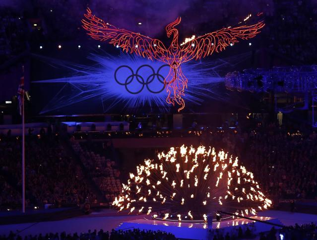 A flaming phoenix flies above the Olympic flame during the closing ceremony of the London 2012 Olympic Games at the Olympic Stadium August 12, 2012. REUTERS/Luke Macgregor (BRITAIN - Tags: OLYMPICS SPORT TPX IMAGES OF THE DAY)