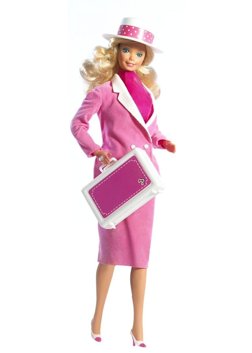 <p>1985's Day to Night Barbie has a practical outfit plan to get her from the office to an evening date in no time flat: It's all about layers. And jaunty hats.</p>