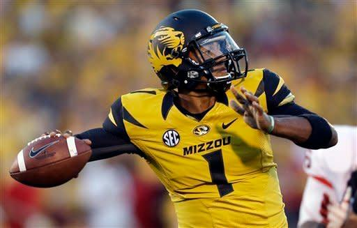 Missouri quarterback James Franklin throws during the first quarter of an NCAA college football game against Georgia Saturday, Sept. 8, 2012, in Columbia, Mo. (AP Photo/Jeff Roberson)