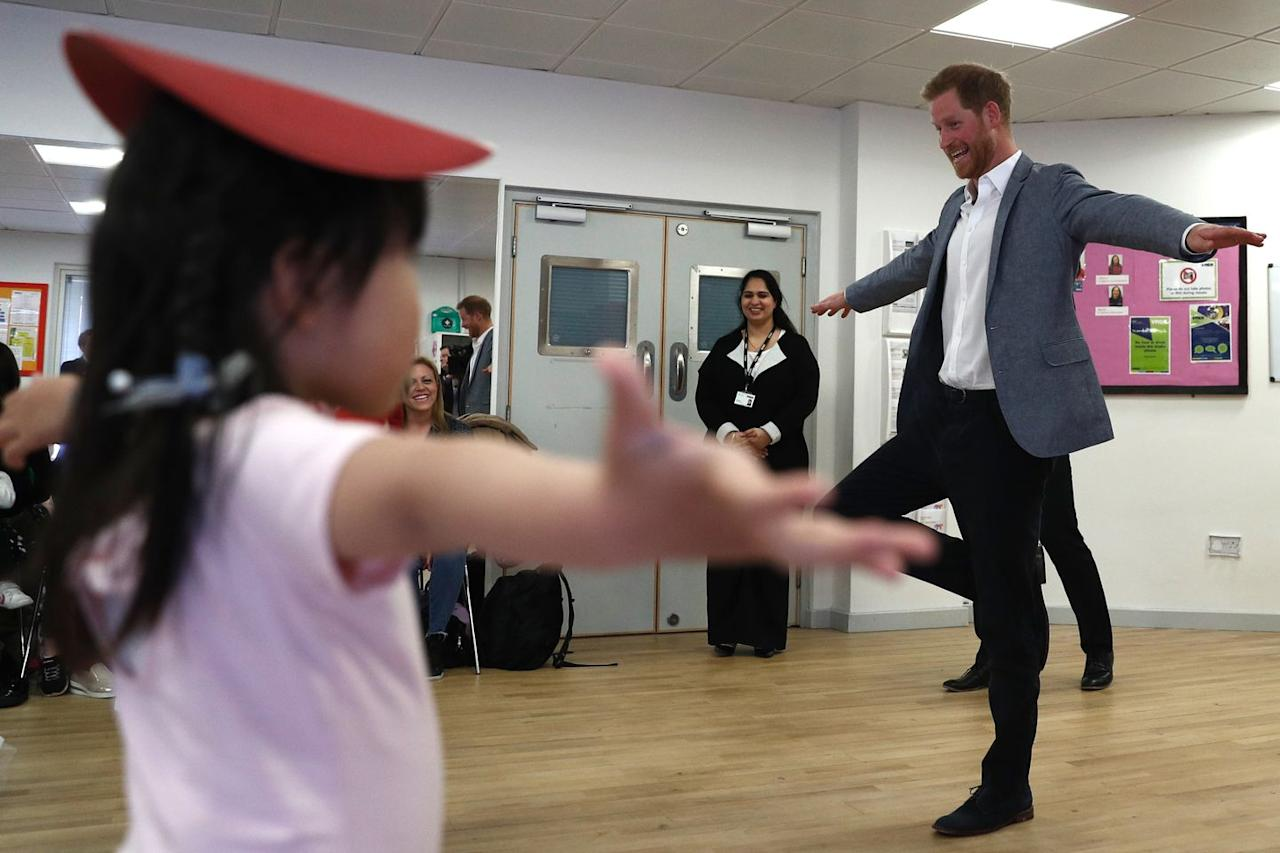 <p>Some young kids try to teach Prince Harry ballet during a visit to YMCA in South Ealing.</p>