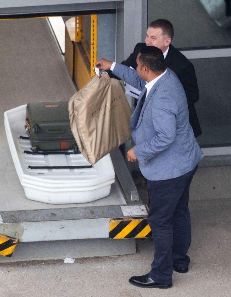 A royal driver was seen collecting Doria bags and her Burberry garment bag at Heathrow Airport.