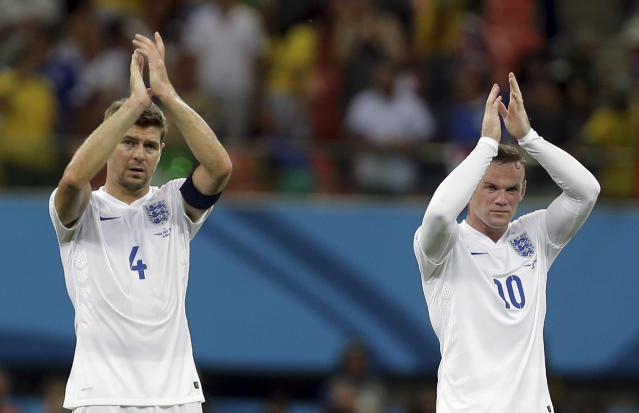 FILE - In this Saturday, June 14, 2014 file photo, England's Steven Gerrard, left, and Wayne Rooney applaud spectators after the group D World Cup soccer match between England and Italy at the Arena da Amazonia in Manaus, Brazil. England captain Steven Gerrard announced his retirement from international football on Monday, July 21, 2014. The 34-year-old Liverpool midfielder made 114 appearances for England over 14 years. (AP Photo/Martin Mejia, File)