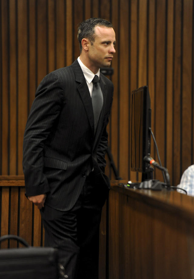 Oscar Pistorius, arrives in court of his murder trial in Pretoria, South Africa, Tuesday, March 18, 2014. Pistorius is on trial for the murder of his girlfriend Reeva Steenkamp on Valentines Day, 2013. (AP Photo/Werner Beukes, Pool)
